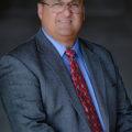 Charles X. Delgado